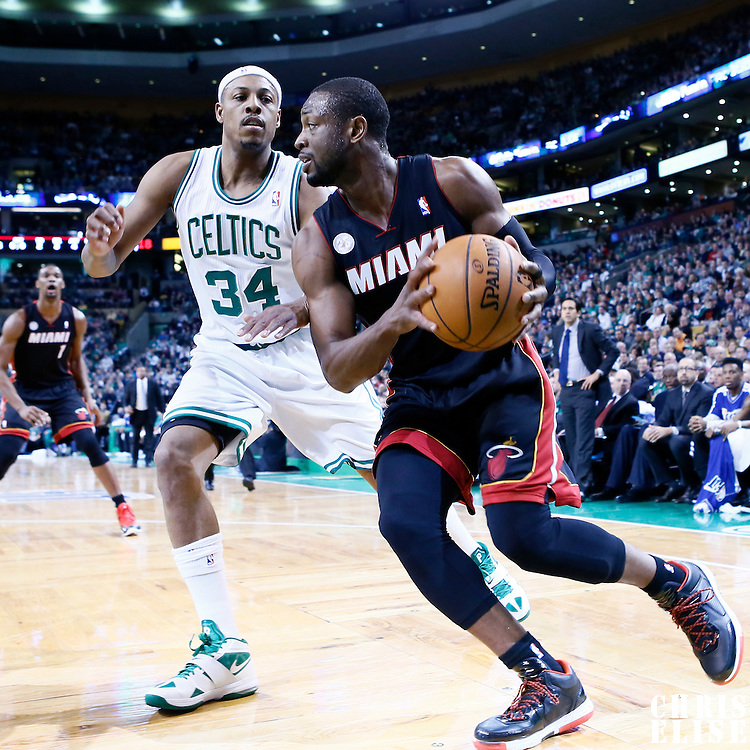 27 January 2013: Miami Heat shooting guard Dwyane Wade (3) drives past Boston Celtics small forward Paul Pierce (34) during the Boston Celtics 100-98  2OT victory over the Miami Heat at the TD Garden, Boston, Massachusetts, USA.