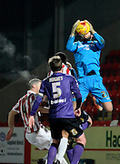 Morecambe goalkeeper Andreas Arestidou claims a cross during the Sky Bet League 2 match between Cheltenham Town and Morecambe at Whaddon Road, Cheltenham, England on 16 January 2015. Photo by Alan Franklin.