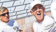 PORTUGAL, Cascais. 7th August 2011. America's Cup World Series. Day 2.  Loick Peyron, (right) interviews Murray Jones in the media zone.