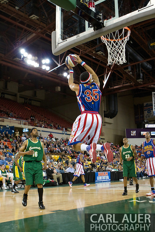 April 30th, 2010 - Anchorage, Alaska:  Harlem Globetrotter Prince Perez (35) dazzels the Anchorage crowd at the Sullivan Arena with a whirling 360 dunk.