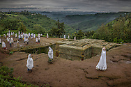 The Ethiopia Highlands are renown for their unique, ancient form of Christianity and magnificent churches carved into the volcanic rock like Bet Giyorgis (St. George's Church) in Lalibela, where worshipers spread out on the solid rock around the church for their open-air Sunday worship service.  Ethiopian Highlands.