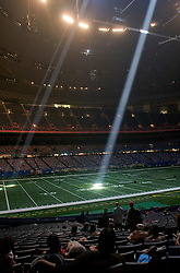 30 August, 2005. New Orleans Louisiana. Hurricane Katrina aftermath. <br /> Light streams through storm damage holes in the ceiling inside the New Orleans Saints' Superdome where as many as 20,000 evacuees take shelter.<br /> Photo Credit: Charlie Varley/varleypix.com