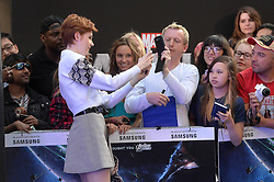 Image ©Licensed to i-Images Picture Agency. 24/07/2014. London, United Kingdom. <br /> <br /> Pictured is actress Karen Gillan taking a selfie with a fan on the red carpet.<br /> <br /> Guardian's of the Galaxy film premiere at Leicester Square, London, UK.<br /> <br /> Picture by Ben Stevens / i-Images