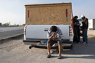 NEWS&GUIDE PHOTO / PRICE CHAMBERS.As the road weary group stops for yet another map check, Juan Carlos Morales rests on his truck's bumper for just a few moments before getting behind the wheel again.