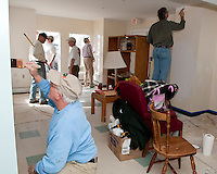 "Spencer Martin along with fellow Gilford Rotarians Dale Squires, David Pereira, Jim Sherman, Rick Moses and Mike Warmington apply a fresh coat of paint to the walls of the Family Wing at the Carey House Saturday morning as part of the ""Adopt a Room"" program.  (Karen Bobotas/for the Laconia Daily Sun)"