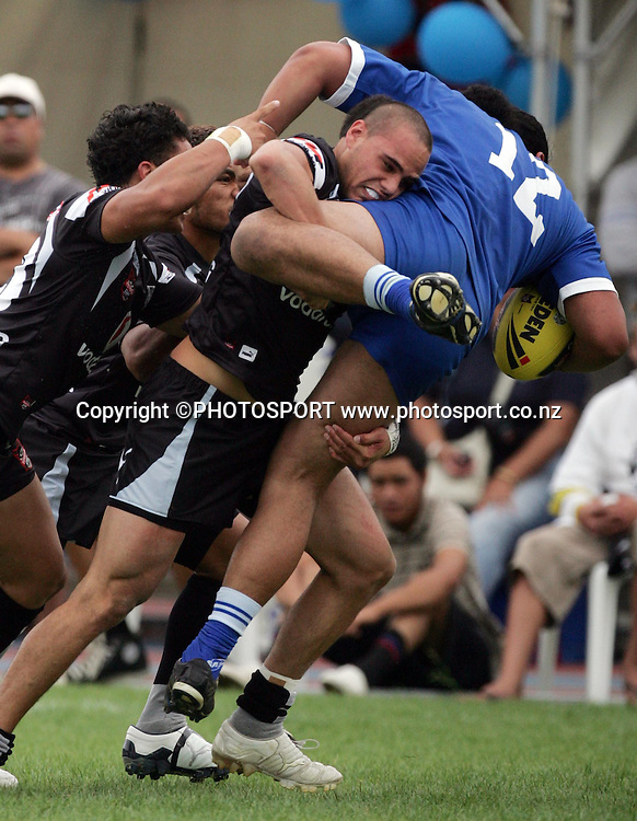 Steve Rapira tackles Solomon Foki into the ground. Junior Warriors v Auckland Selection, Mt Smart No.2, Auckland, Sunday 10 February 2008. Photo: Renee McKay/PHOTOSPORT