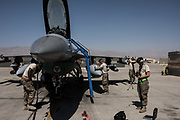 BAGRAM, AFGHANISTAN - SEPTEMBER 5: Members of the United States Air Force deployed for Mission Resolute Support prepare an F-16 Jet for a flight at Bagram Air Field on September 5, 2017 in Bagram, Afghanistan. Currently the United States has about 11,000 troops in the deployed in Afghanistan, with a reported 4,000 more expected to arrive in the coming weeks. Last month, President Donald Trump announced his plan for Afghanistan which called for an increase in troop numbers and a new conditions-based approach to the war, getting rid of a timetable for the withdrawal of American forces in the country.(Photo by Andrew Renneisen/Getty Images)