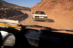 Travelling on a road covered with sand and dirt after a recent landslide between Imlil and Marrakech in the High Atlas, Morocco.