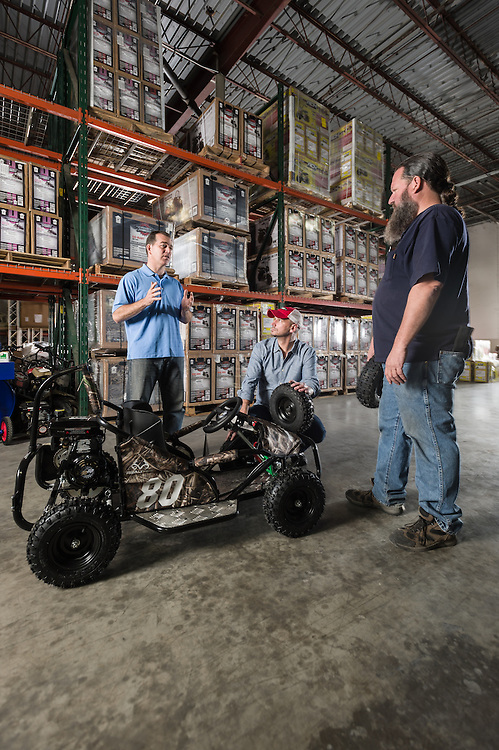 01/14/2016 133429 -- Garland, TX -- &copy; Copyright 2016 Mark C. Greenberg<br /> <br /> From left: President and COO Rick Sukkar and CEO Alex Keechleof talk with warehouse manager Kevin Sadler in the warehouse of Garland, Texas based Monster Moto