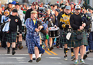 (010116 BOSTON MA)-Sporting a bathrobe, Pipe Major Kevin Conroy leads swimmers and the Greater Boston Firefighters Pipe and Drum Corps to the water for the annual L Street Brownies New Year's Day swim in South Boston. Herald photo by Chris Christo