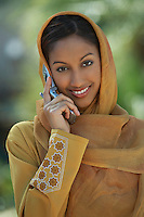 Portrait of muslim woman talking on mobile