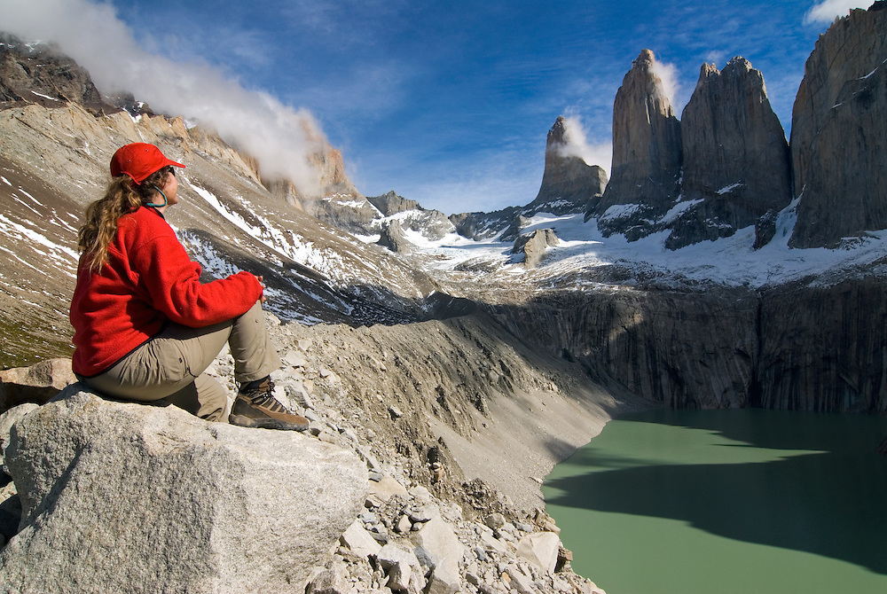 Hiker gazing out at Torres Del Paine, Torres Del Paine National Park, Chile.