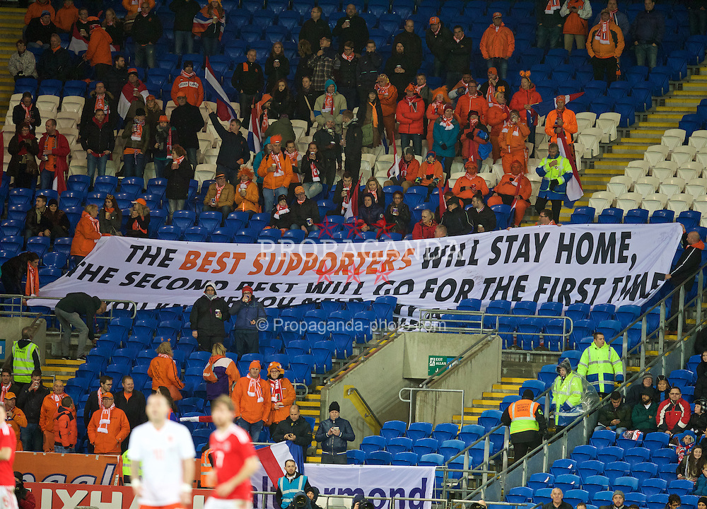 CARDIFF, WALES - Friday, November 13, 2015: The Netherlands supporter with a banner before the International Friendly match against Wales at the Cardiff City Stadium. (Pic by David Rawcliffe/Propaganda)