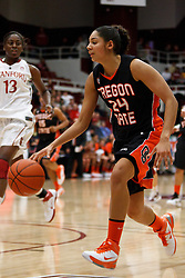 February 24, 2011; Stanford, CA, USA;  Oregon State Beavers guard Alyssa Martin (24) dribbles past Stanford Cardinal forward Chiney Ogwumike (13) during the first half at Maples Pavilion.  Stanford defeated Oregon State 73-37.