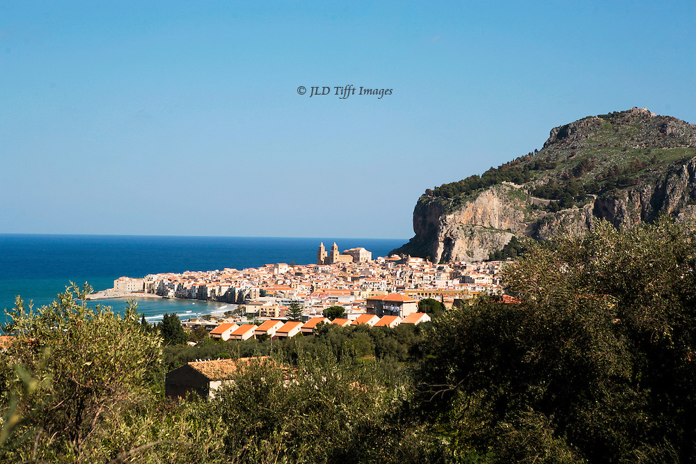 Cefalu, Cathedral in its setting, beneath cliff by the sea..