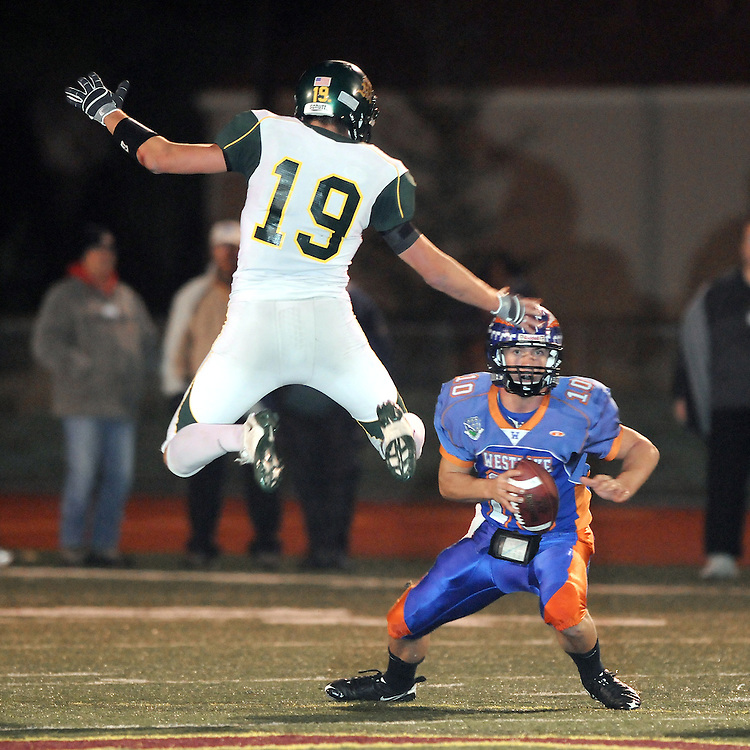 H:\EDITORIAL\Photos\12 December 2009\JH 12-17-09  Westlake QB scrambles for yardage past a leaping Brian Blechen in the first quarter of the CIF Northern Divison 2 final at Simi Valley High School on Friday, December 11 in SImi Valley.
