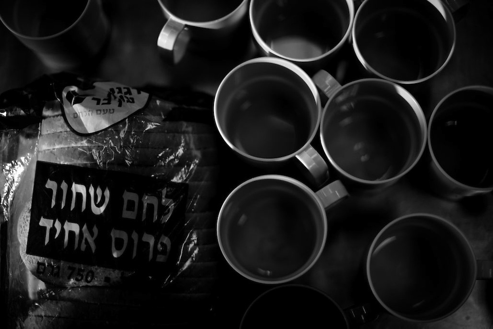 Plastic cups and bread are placed in on a table att the dining room in the Shaar Menashe Mental Health Center for Holocaust survivors in Pardes Hanna, Israel on Jan 3, 2011.
