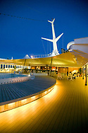 A view of the rear deck of the MV Explorer, a cruise ship, at twilight.  The MV Explorer is a cruise ship that has been converted into a floating university.