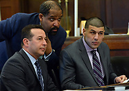 (BOSTON, MA 020317) From left, lead defense attorney Jose Baez, defense attorney Ronald Sullivan and Aaron Hernandez listen to Judge Jeffrey Locke during a hearing requesting a continuance in Hernandez' upcoming double murder trial. Staff photo Chris Christo