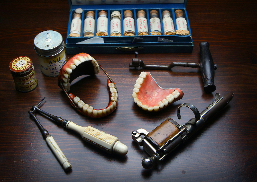 The Royal Dental Hospital of Melbourne will be turning 120 this Sunday. Some items that are on display in the dental museum, centre dentures from 1900s, (clockwise from back) porcelain enamel stains c1890, dental extraction key c1840, electrical gold packer c1900, 2 handed drill c1850, floss c1900  - Pic By Craig Sillitoe 09/09/2010 melbourne photographers, commercial photographers, industrial photographers, corporate photographer, architectural photographers, This photograph can be used for non commercial uses with attribution. Credit: Craig Sillitoe Photography / http://www.csillitoe.com<br />