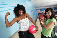 Young Women in Bowling Alley