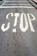worn stop signal on an damaged asphalt road