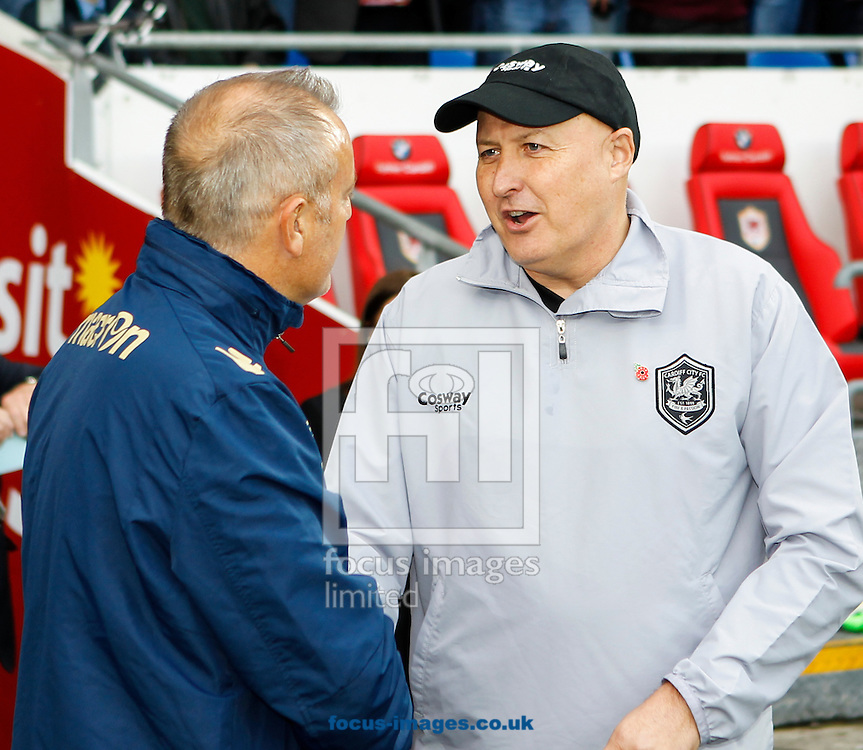 Russell Slade of Cardiff City and Neil Redfearn of Leeds United during the Sky Bet Championship match at the Cardiff City Stadium, Cardiff<br /> Picture by Mike  Griffiths/Focus Images Ltd +44 7766 223933<br /> 01/11/2014