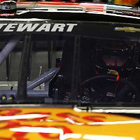 Driver Tony Stewart adjusts his steering wheel in the garage during the  56th Annual NASCAR Daytona 500 practice session at Daytona International Speedway on Wednesday, February 19, 2014 in Daytona Beach, Florida.  (AP Photo/Alex Menendez)