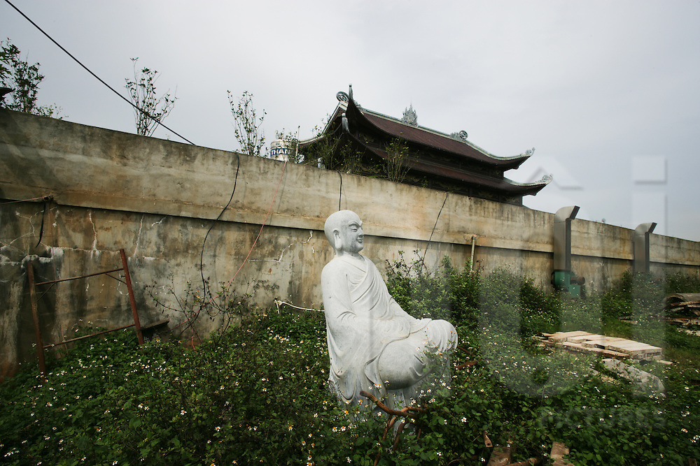 Abandoned Buddha statue next to Bai Dinh Pagoda in Ninh Binh, the largest pagoda in Northern Vietnam, Southeast Asia