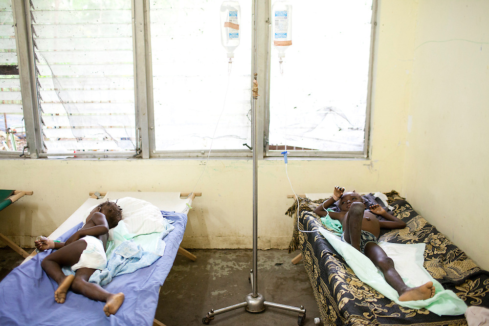Young cholera patients sleep on cots at the Hospital Albert Schweitzer on Thursday, October 28, 2010 in Deschapelles, Haiti.