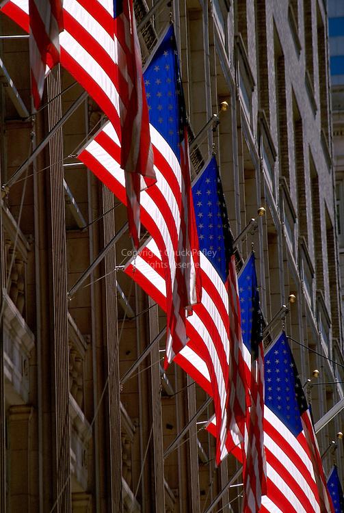 USA flags on Saks Fifth Avenue building, Manhattan, New York, New York