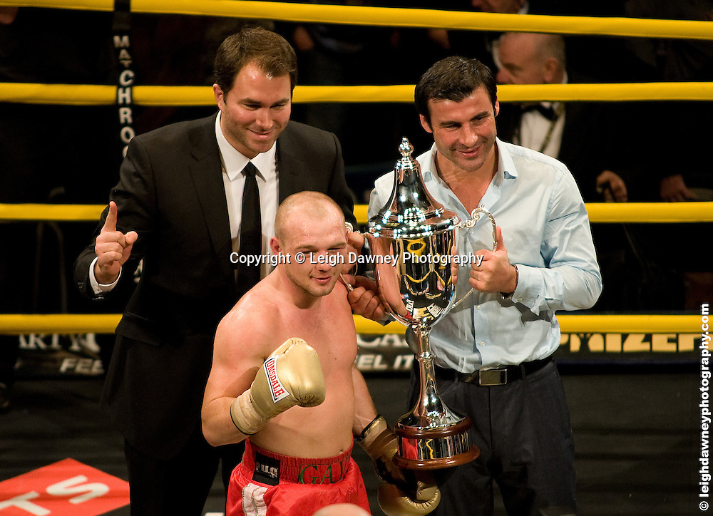 Gavin Rees (red shorts) claiming Prizefighter defeats Colin Lynes at London Olympia, trophy presented by Joe Calzaghe with Eddie Hearn -  Prizefighter Light Welterweights 4th December 2009 Credit: © Leigh Dawney Photography