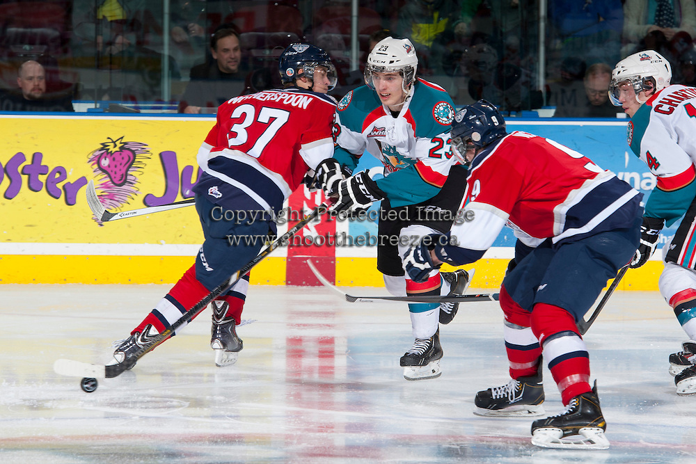 KELOWNA, CANADA -FEBRUARY 19:  Parker Wotherspoon #37 of the Tri City Americans checks Justin Kirkland #23 of the Kelowna Rockets during third period on February 19, 2014 at Prospera Place in Kelowna, British Columbia, Canada.   (Photo by Marissa Baecker/Getty Images)  *** Local Caption *** Parker Wotherspoon; Justin Kirkland;