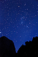The constellation Orion rises over the Great White Throne in Zion National Park.
