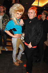 Left to right, JODIE HARSH and PEREZ HILTON at a party hosted by Mulberry to celebrate the publication of The Meaning of Sunglasses by Hadley Freeman held at Mulberry 41-42 New Bond Street, London on 14th February 2008.<br />