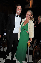 RICHARD STEELE and CHRISTINA KNUDSEN at a dinner in aid of Caring For Courage - The Royal Scots Dragoon Guards Afghanistan Welfare Appeal held at The Royal Hospital Chelsea, London SW3 on 20th October 2011.