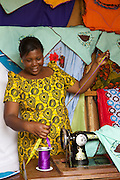 Anna Nyamanda measuring out some ribbon in her shop.<br /> <br /> Anna set up and now runs a tailoring business selling a variety of home furnishings in Mwanalugali, Tanzania.<br /> <br /> She attended MKUBWA enterprise training run by the Tanzania Gatsby Trust in partnership with The Cherie Blair Foundation for Women.