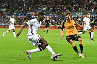 Football - 2019 / 2020 EFL Carabao (League) Cup - Second Round: Swansea City vs. Cambridge United<br /> <br /> Jordan Garrick of Swansea City on the attack Harrison Dunk of Cambridge United   defends , at Liberty Stadium.<br /> <br /> COLORSPORT/WINSTON BYNORTH