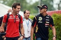 (L to R): Jules Bianchi (FRA) Marussia F1 Team with Pastor Maldonado (VEN) Lotus F1 Team.<br /> Italian Grand Prix, Friday 5th September 2014. Monza Italy.
