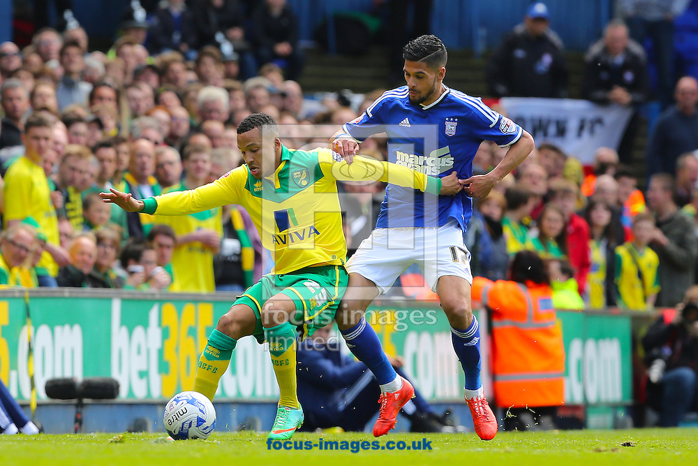 Martin Olsson of Norwich City holds off Kevin Bru of Ipswich Town during the Sky Bet Championship play off semi final first leg at Portman Road, Ipswich<br /> Picture by Richard Calver/Focus Images Ltd +44 7792 981244<br /> 09/05/2015