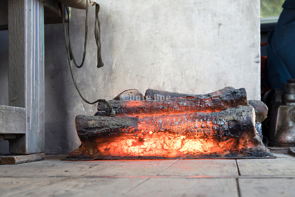 ornamental artificial fireplace on a wooden floor