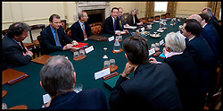 The Prime Minister David Cameron and the Deputy Prime Minister Nick Clegg hold The National Security Council Meeting in the Cabinet Room in Downing Street, London, Wednesday May 12, 2010, with Cabinet Secretary Sir Gus O'Donnell (2nd left, red folder on the table). The  Cabinet Secretary Sir Gus O'Donnell steps down at the end of the year and is replaced by Jeremy Heywood (left), currently Permanent Secretary at No. 10, will replace Gus O'Donnell as Cabinet Secretary. Photo By Andrew Parsons/ i-Images