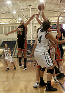 Despite pressure from Beavercreek's Mikaela Ruef (44,) Fairmont's  Cassie Sant gets a shot off as the Beavercreek Lady Beavers take on Kettering's Fairmont High School Lady Firebirds Wednesday night, January 31, 2007.