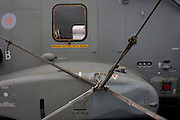 Detail of cables securing the fuselage of an AgustaWestland AW101 helicopter. The Merlin is a medium-lift helicopter used in both military and civil applications. It was developed by joint venture between Westland Helicopters in the UK and Agusta in Italy and was named the EH101 until 2007.  The helicopter is on-board the Royal Navy's aircraft carrier HMS Illustrious during a public open-day on the river Thames in Greenwich.
