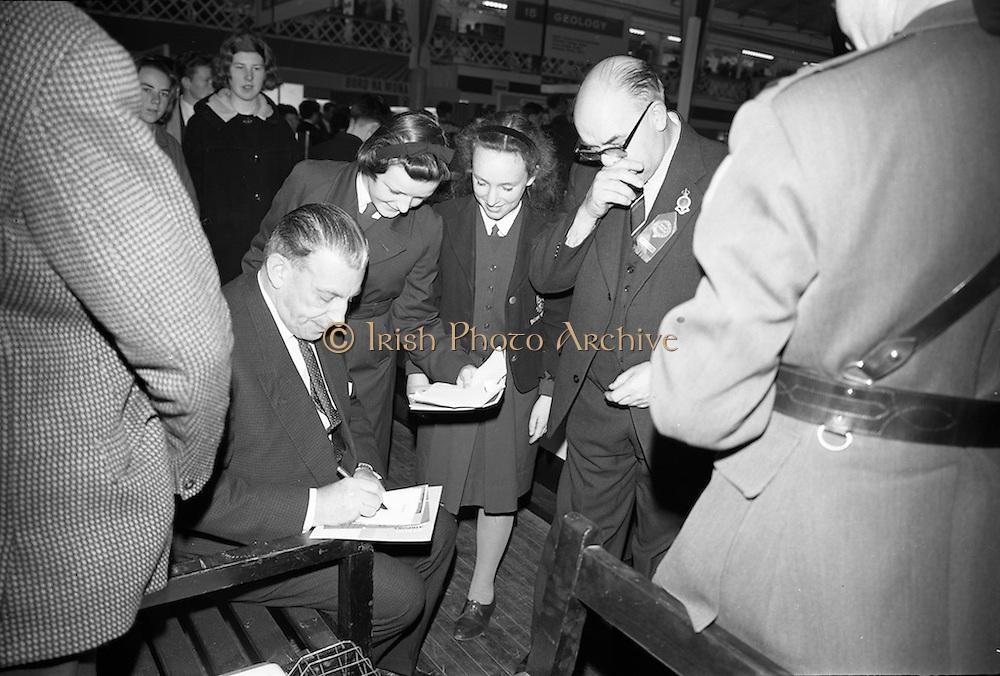 22/10/1963<br /> 10/22/1963<br /> 22 October 1963<br /> R.D.S. Scientific Exhibition opens, Ballsbridge, Dublin.  Taoiseach Sean Lemass signs autographs for students attending the exhibition.