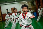 Training at a Taekwondo school for children in Daegu. Taekwondo is a Korean martial art and the national sport of South Korea.