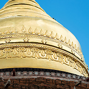 BAGAN, MYANMAR--The Dhammayazika Pagoda (also Dhamma-ya-ka Zedi) is a Buddhist temple located in the village of Pwasaw, in the southern section of the Bagan plain, in Myanmar. It was built in 1196 during the reign of King Narapatisithu. The pagoda is circular in design, and is made of brick. Its three terraces contain terra cotta tiles illustrating scenes from the Jataka, and it is now convered with a large gold umbrella dome.