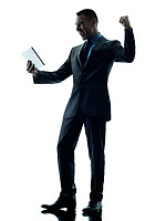 one caucasian business man standing using digital tablet  happy silhouette isolated on white background