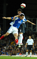 Photo: Ed Godden.<br /> Portsmouth v Bolton Wanderers. The Barclays Premiership. 25/09/2006. Gary Speed (R) leaps high above Portsmouth's  Sean Davis.