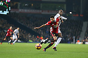 Jess Lingard Midfielder of Manchester United battles with West Bromwich Albion Defender Allan-Romeo Nyom during the Premier League match between West Bromwich Albion and Manchester United at The Hawthorns, West Bromwich, England on 17 December 2016. Photo by Phil Duncan.